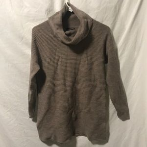 Cowl neck tunic in 100% extra fine marino wool.